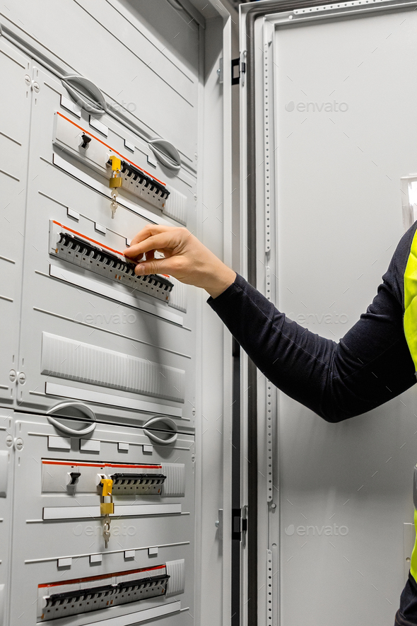 Male Electrician Checking Electric Fuse Board In Server Room - Stock Photo - Images