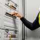 Male Electrician Checking Electric Fuse Board In Server Room - PhotoDune Item for Sale