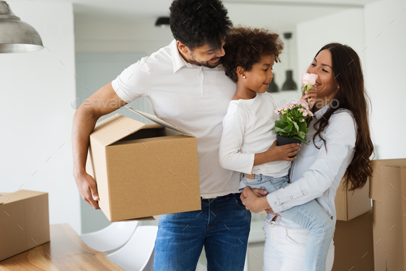 Happy family with cardboard boxes - Stock Photo - Images