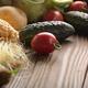 Fresh Organic Vegetable Food Ingredients on Wooden kitchen table - PhotoDune Item for Sale