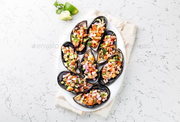 Perivian Dish. Choros a La Chalaca. Big Mussels with Tomatoes, Lemon, purple Onion - Stock Photo - Images