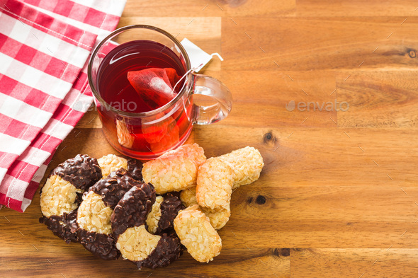 Sweet biscuits dessert and red fruity tea. - Stock Photo - Images