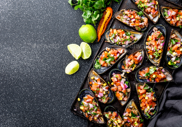 Peruvian Choros a La Chalaca. Mussels with Tomato, Onion and Cilantro Sauce. Copy Space - Stock Photo - Images