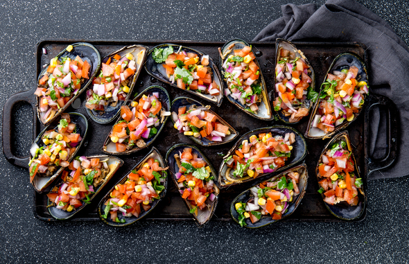 Peruvian Choros a La Chalaca. Mussels with Tomato, Onion and Cilantro Sauce. Top view - Stock Photo - Images