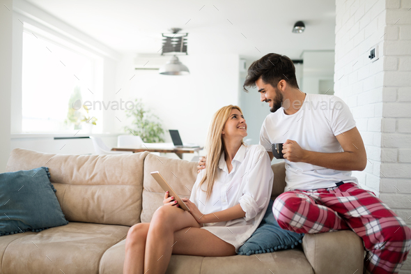 Young attractive couple spending time together at home - Stock Photo - Images