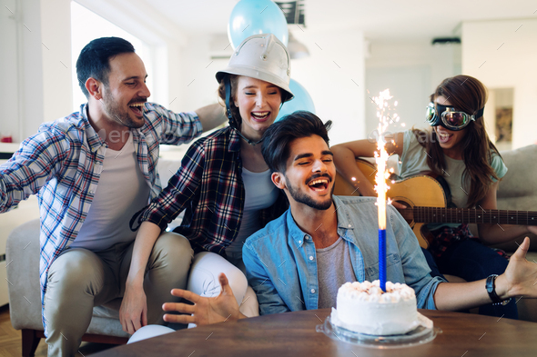 Cheerful young friends having fun on party - Stock Photo - Images