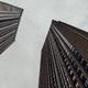 Low angle view of skyscrapers. Moody tone photography. - PhotoDune Item for Sale
