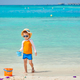 Three year old toddler playing on beach - PhotoDune Item for Sale