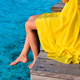 Woman sitting at beach jetty - PhotoDune Item for Sale
