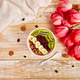 Bowl with Granola, banana, kiwi, berry with pink tulip flowers - PhotoDune Item for Sale