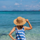Young woman relaxing and enjoying at the tropical beach, Summer vacation and travel concept - PhotoDune Item for Sale