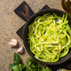 Zucchini noodles in frying pan top view - PhotoDune Item for Sale