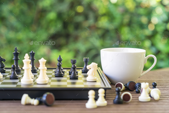 Coffee cup on wood table with Chess board-3 - Stock Photo - Images