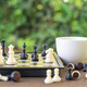 Coffee cup on wood table with Chess board-3 - PhotoDune Item for Sale