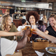 Group Of Young Friends Meeting For Drinks And Food Making A Toast In Restaurant - PhotoDune Item for Sale