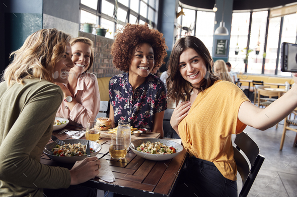 Four Young Female Friends Meeting For Drinks And Food Posing For Selfie In Restaurant - Stock Photo - Images