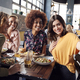 Four Young Female Friends Meeting For Drinks And Food Posing For Selfie In Restaurant - PhotoDune Item for Sale