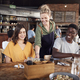 Waitress Serving Group Of Young Friends Meeting For Drinks And Food In Restaurant - PhotoDune Item for Sale
