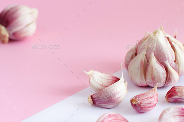 Fresh garlic on a light pink background - Stock Photo - Images