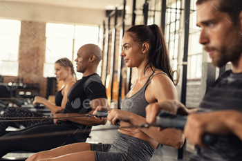 Fitness class training on rowing machine