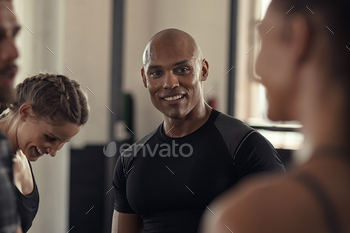 Fitness people talking in gym