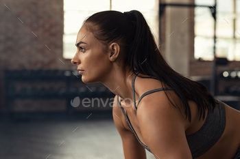 Determined muscular woman in gym