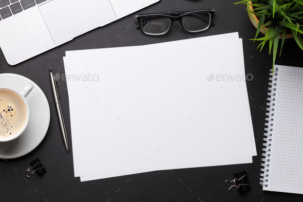 Office workplace table with blank paper page - Stock Photo - Images