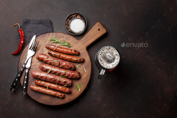 Grilled sausages and beer - Stock Photo - Images