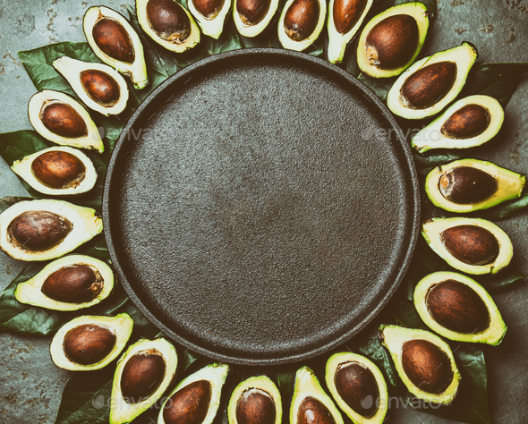 Food Background with Avocado and Avocado Tree Leaves. Copy Space - Stock Photo - Images