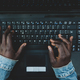 Young african woman typing on the laptop keyboard. - PhotoDune Item for Sale