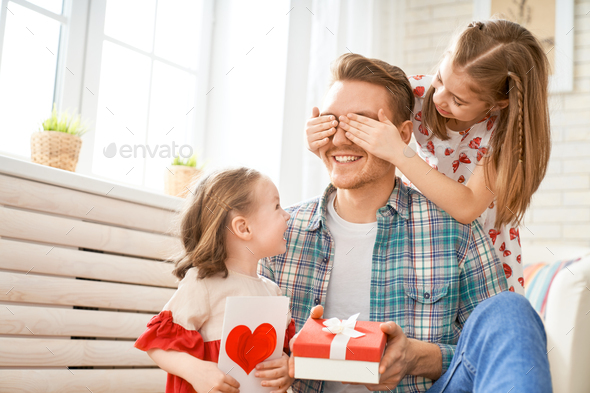 daughters congratulating dad - Stock Photo - Images
