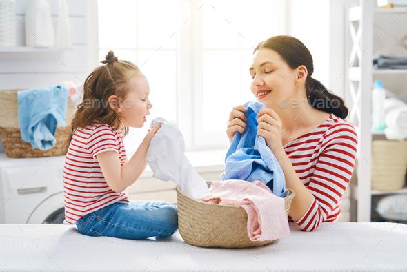 family doing laundry - Stock Photo - Images
