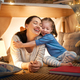 mother and daughter playing in tent - PhotoDune Item for Sale