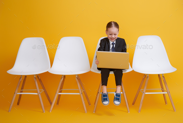 baby girl working on a computer - Stock Photo - Images