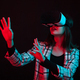 Beautiful young girl reaching out with her hands and wearing virtual reality goggles in studio with - PhotoDune Item for Sale
