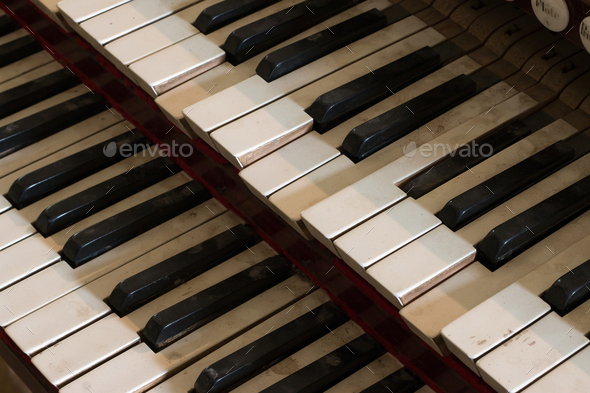 Detail of old, broken and dusty organ keys - Stock Photo - Images
