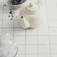 White teapot on the checkered table cloth - PhotoDune Item for Sale