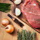 Raw meat from the butcher shop on wooden board with ingredients - PhotoDune Item for Sale