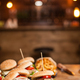 Close up of burgers with lettuce and counter bar blurred in the background - PhotoDune Item for Sale