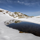 Snowy mountains reflected in an alpine lagoon - PhotoDune Item for Sale