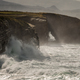 Groundswell under the rocky cliffs and stone arch - PhotoDune Item for Sale