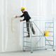 worker plastering gypsum board wall. - PhotoDune Item for Sale