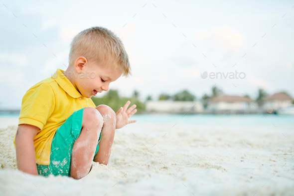 Three year old toddler boy on beach - Stock Photo - Images