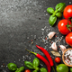 Tomatoes, spices and basil leaves on black background - PhotoDune Item for Sale