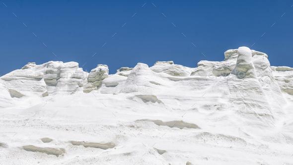 Milos Island Sarakiniko Volcanic White Stone Texture with Blue Sky - Stock Photo - Images