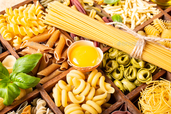 Assorted colorful italian pasta in wooden box - Stock Photo - Images