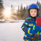 Little boy  holding his skis in winter - PhotoDune Item for Sale