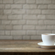 White coffee mug on a wooden table And white brick background. - PhotoDune Item for Sale