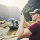 Tourist with mobile phone on boat - PhotoDune Item for Sale