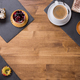 Top viwe of a cup of coffee with different cakes with different flavours over a wooden table - PhotoDune Item for Sale